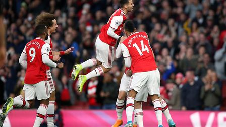 Arsenal's Sokratis Papastathopoulos celebrates scoring his side's first goal of the game during the
