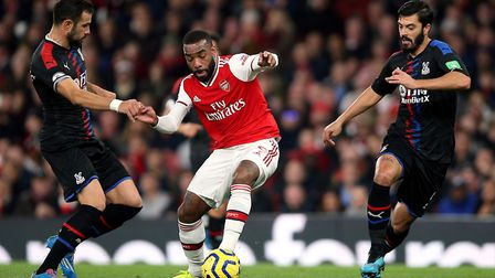 Arsenal's Alexandre Lacazette and Crystal Palace's Luka Milivojevic (left) battle for the ball durin