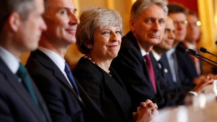 Prime minister Theresa May with members of her cabinet, Gavin Williamson, Jeremy Hunt, Philip Hammon