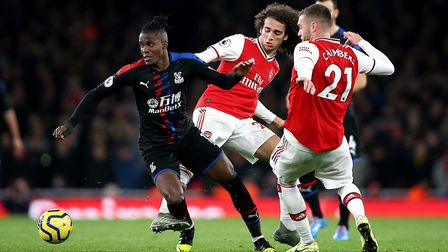Crystal Palace's Wilfried Zaha (left) and Arsenal's Matteo Guendouzi during the Premier League match