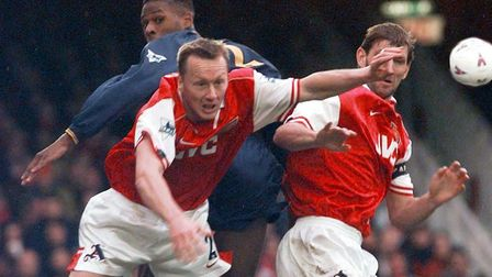 Arsenal defenders Lee Dixon (left) and captain Tony Adams combine to deny Wimbledon's Carl Cort at H