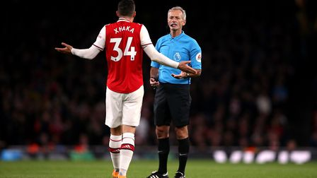 Arsenal's Granit Xhaka speaks to referee Martin Atkinson during the Premier League match at the Emir