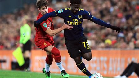 Arsenal's Bukayo Saka (right) in action during the Carabao Cup, Fourth Round match at Anfield, Liver