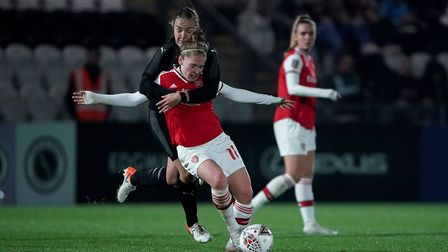 Arsenal's Kim Little is challenged during the UEFA Women's Champions League round of 16 second leg m