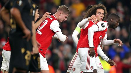 Arsenal's Nicolas Pepe celebrates scoring his side's second goal of the game with team mates during