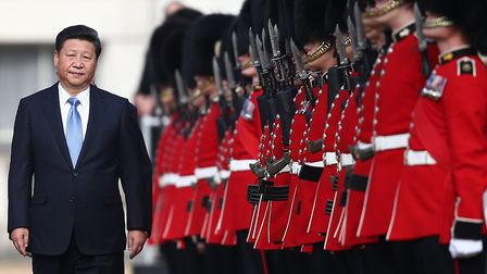 Chinas President Xi Jinping reviews a guard of honour on his state visit to London in 2015 Photo: G