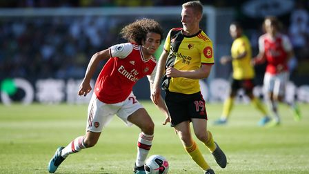 Arsenal's Matteo Guendouzi (left) and Watford's Will Hughes battle for the ball during the Premier L