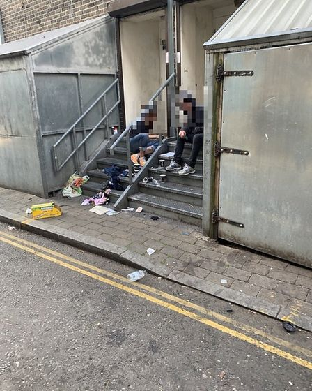 People allgedly taking drugs on the steps of The White Swan pub.