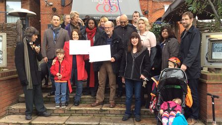 Campaigners, councillors and parliamentary candidates opposing a wrecking ball to the Queensbury Pub