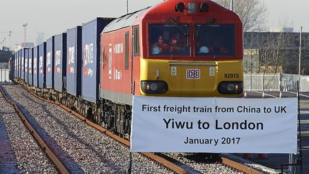 A freight train transporting containers laden with goods from China, arrives at DB Cargos London Eu