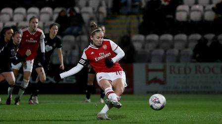 Arsenal'�s Kim Little scores her side's third goal from the penalty spot during the Women's League C
