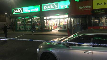 A police cordon was put up after a bus driver hit a man in Stroud Green Road. Picture: Lucas Cumiske