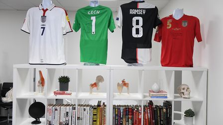 Shirts from investors Petr Cech and Aaron Ramsey on display at the Lewin Sports Injury Clinic (pic S