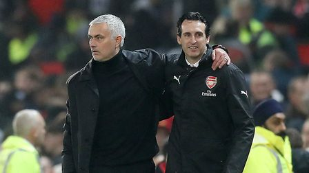 Manchester United manager Jose Mourinho (left) and Arsenal manager Unai Emery react after the final