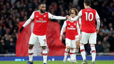 Arsenal's Alexandre Lacazette celebrates scoring his side's first goal of the game with team-mate Me