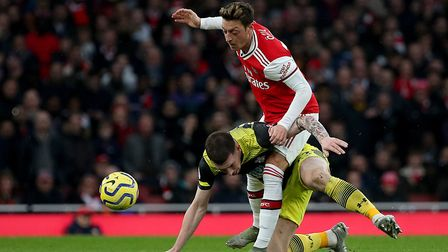 Southampton's Pierre-Emile Hojbjerg (left) and Arsenal's Mesut Ozil battle for the ball during the P