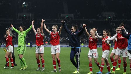 Arsenal players celebrate after winning the FA Women's Super League match at the Tottenham Hotspur S