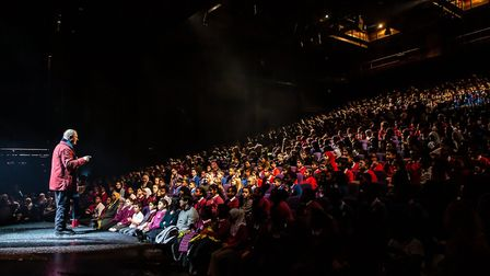 Michael Morpurgo addresses Brent pupils ahead of a performance of War Horse in Wembley Park. Picture