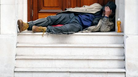 A stock image of a homeless man sleeping in a doorway. Picture: PA
