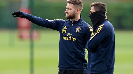 Arsenal's Shkodran Mustafi and Mesut Ozil (right) during the training session at London Colney. Pict