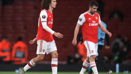 Arsenal's Matteo Guendouzi (left) reacts after the final whistle during the UEFA Europa League Group
