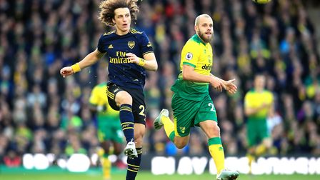 Arsenal's David Luiz (left) and Norwich City's Teemu Pukki battle for the ball during the Premier Le