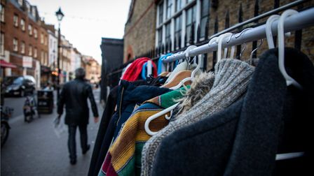 The coat rack set up as part of the Take One, Leave One project in Exmouth Market.