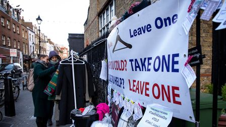 The coat rack and 'pledge cards', part of the Take One, Leave One project in Exmouth Market.