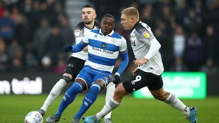 Queens Park Rangers' Bright Osayi-Samuel (centre) takes on Derby County's Scott Malone (left) and Ma