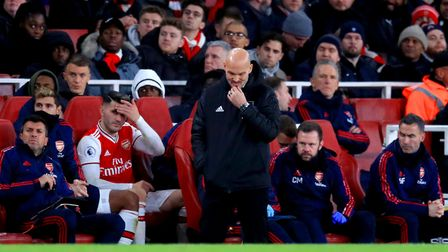 Arsenal interim manager Freddie Ljungberg reacts on the touchline during the Premier League match at