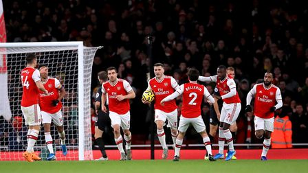 Arsenal's Alexandre Lacazette (right) celebrates scoring his side's first goal of the game with his