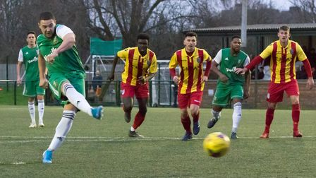 Liam Brooks directs his penalty kick goalwards to double Hendon's lead (pic DBeechPhotography)