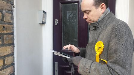 Lib Dem candidate for Hampstead and Kilburn Matt Sanders waits to speak to a voter on a doorstep in