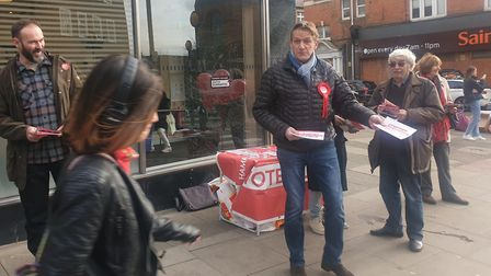 Labour campaigners try to win around a member of the public in West End Lane. Picture: Harry Taylor
