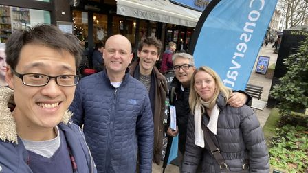 Hampstead and Kilburn Conservative candidate Johnny Luk with Tory activists in West End Lane on Satu