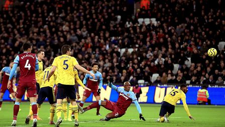 West Ham United's Angelo Ogbonna (centre) scores his side's first goal of the game during the Premie