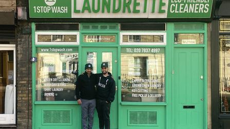 Paul and Rohit Dillion outside 1 Stop Wash in Caledonian Road.