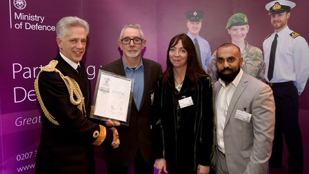 Sue Ferrier and Muazzam Khokher, right, receiving the award,
