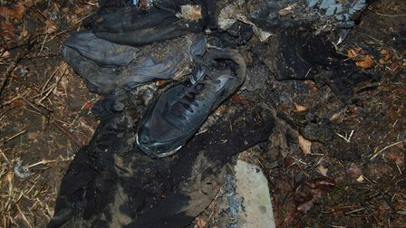 Metropolitan Police undated handout photo of burnt clothes belonging to Ayoub Majdouline who has bee