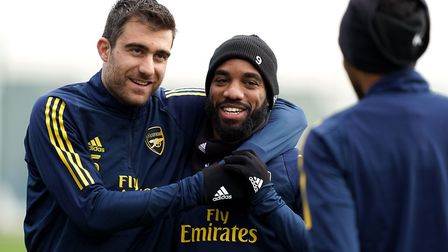Arsenal's Sokratis Papastathopoulos (left) and Alexandre Lacazette during a training session at Lond