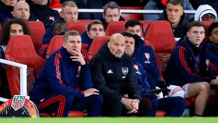 Arsenal interim manager Freddie Ljungberg watches the match action from the bench during the Premier