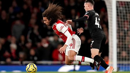 Arsenal's Matteo Guendouzi (left) and Manchester City's Phil Foden battle for the ball during the Pr