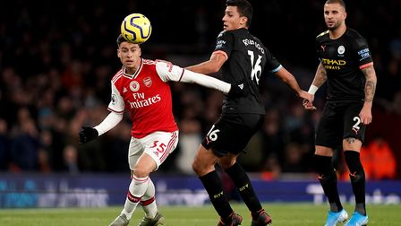 Arsenal's Gabriel Martinelli (left) and Manchester City's Rodri battle for the ball during the Premi