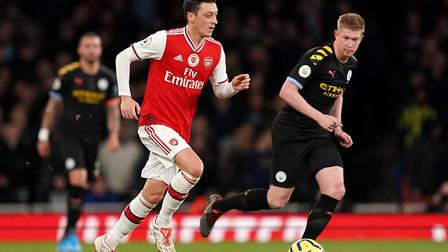 Arsenal's Mesut Ozil (left) in action with Manchester City's Kevin De Bruyne during the Premier Leag