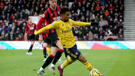 Arsenal's Reiss Nelson (right) in action as Bournemouth's Jack Simpson looks on
