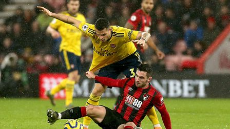 Arsenal's Granit Xhaka (top) and Bournemouth's Lewis Cook (bottom) battle for the ball