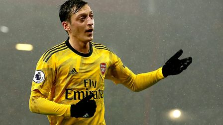 Arsenal's Mesut Ozil gestures to the fans