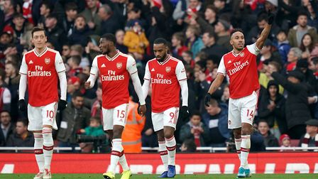 Arsenal's Pierre-Emerick Aubameyang (right) celebrates scoring his side's first goal of the game dur