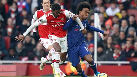 Arsenal's Ainsley Maitland-Niles (left) and Chelsea's Willian battle for the ball during the Premier