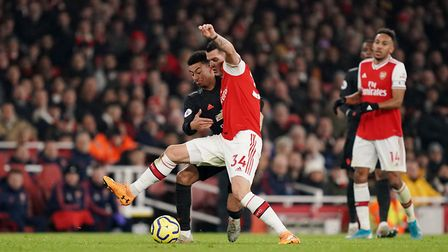 Manchester United's Jesse Lingard (left) and Arsenal's Granit Xhaka battle for the ball during the P